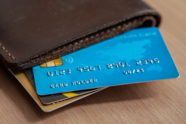 credit cards in a wallet on wooden table. open access for online shopping - credit card imagens e fotografias de stock