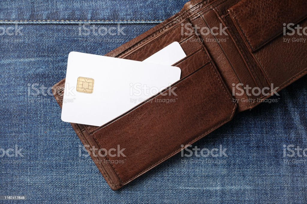 Blank white credit cards in leather wallet on denim background. Flat...