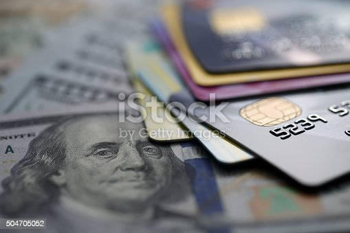 istock credit cards on dollars 504705052