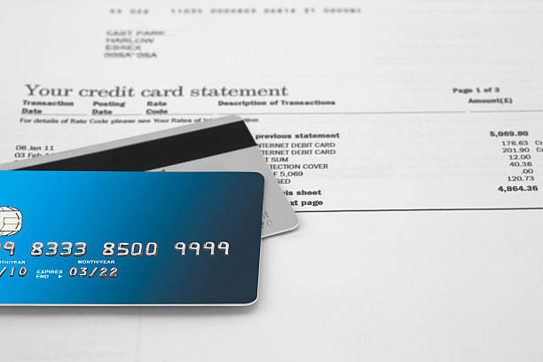 Credit Cards Credit Cards on Bank Statements bank statement stock pictures, royalty-free photos & images