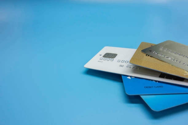 credit cards stacked together - foto di credit card foto e immagini stock