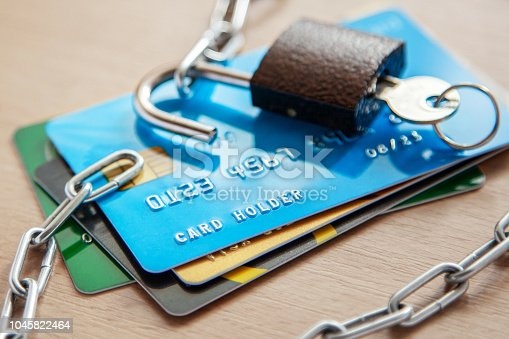 Credit cards with an open lock and chain. Open access to the use of electronic money