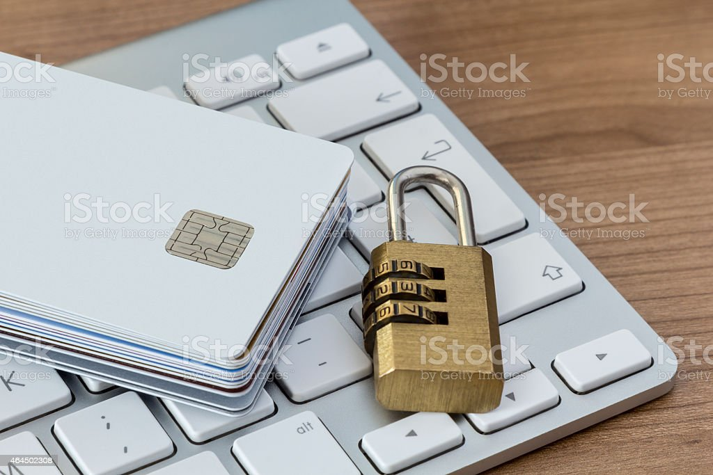 Credit cards with lock on a keyboard stock photo