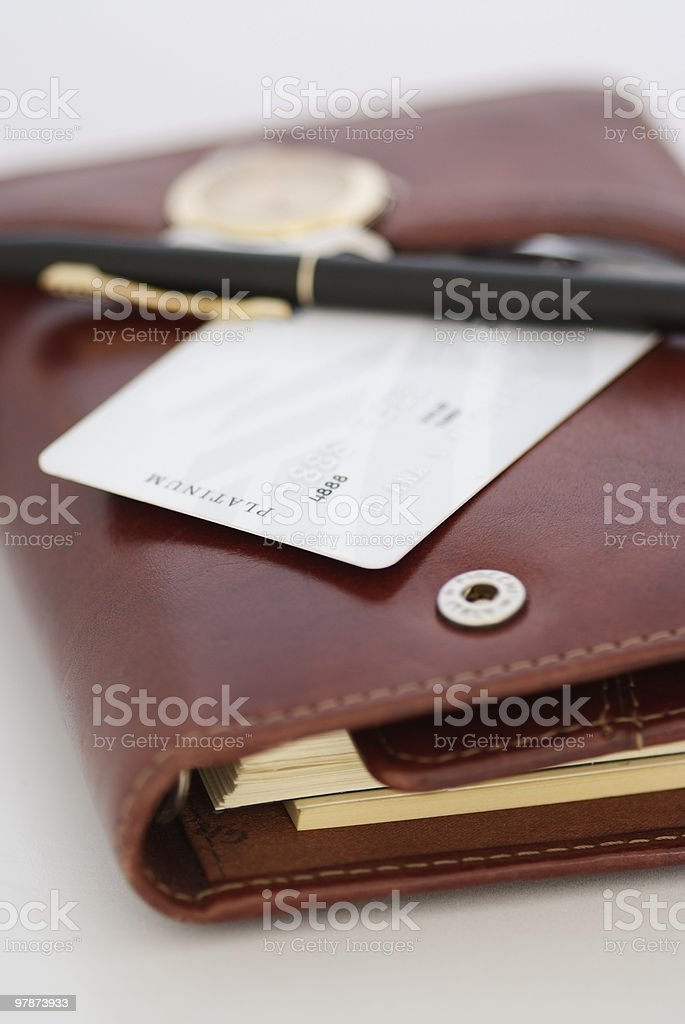 credit card,watch and a pen on an agenda royalty-free stock photo