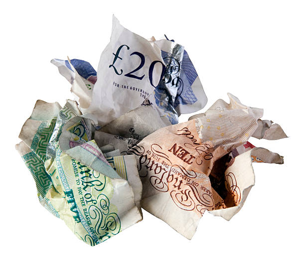 Credit crunch - crumpled British bank notes stock photo