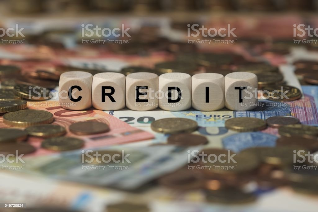 credit - cube with letters, money sector terms - sign with wooden cubes stock photo
