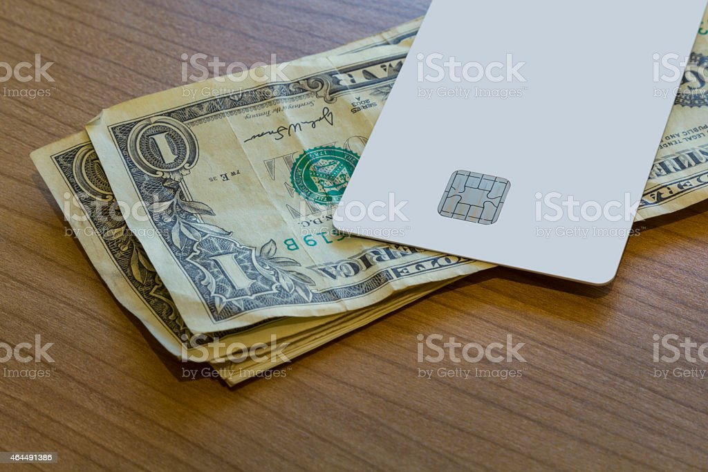 Credit or Debit Card on Dollar Notes stock photo