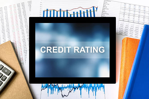 credit rating word on tablet stock photo