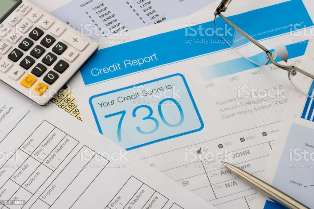 Credit report form on a desk with other paperwork. stock photo