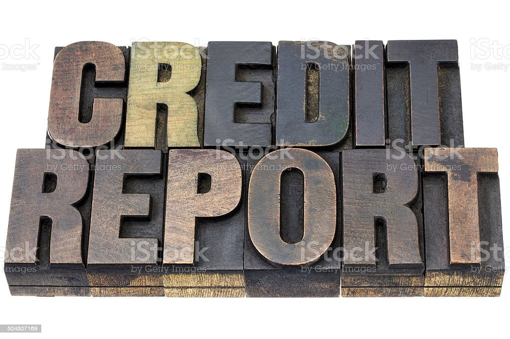 credit report in wood type stock photo