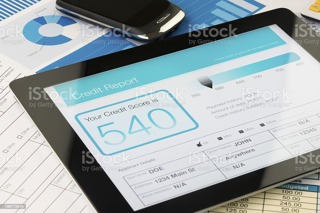 Credit report on a digital tablet royalty-free stock photo