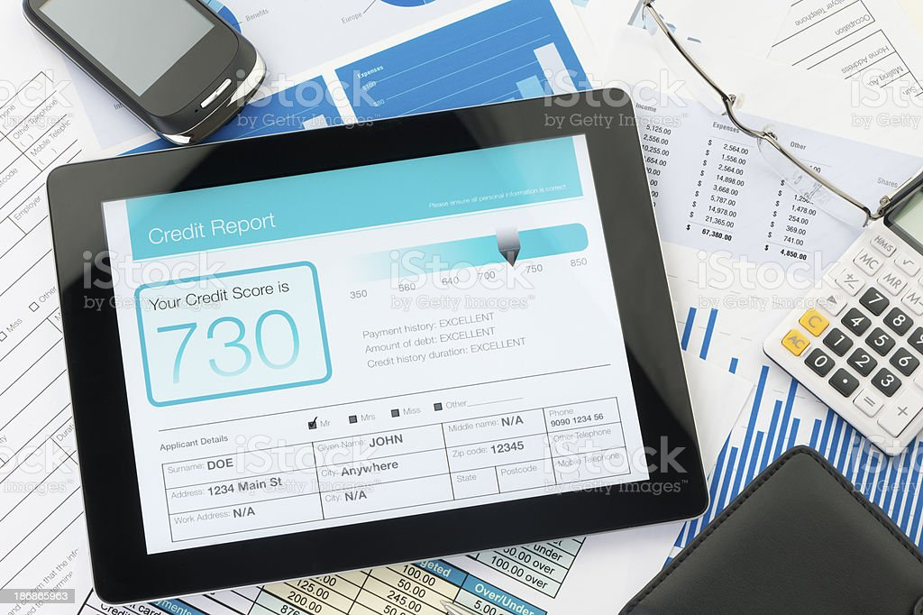 Credit report on a digital tablet stock photo
