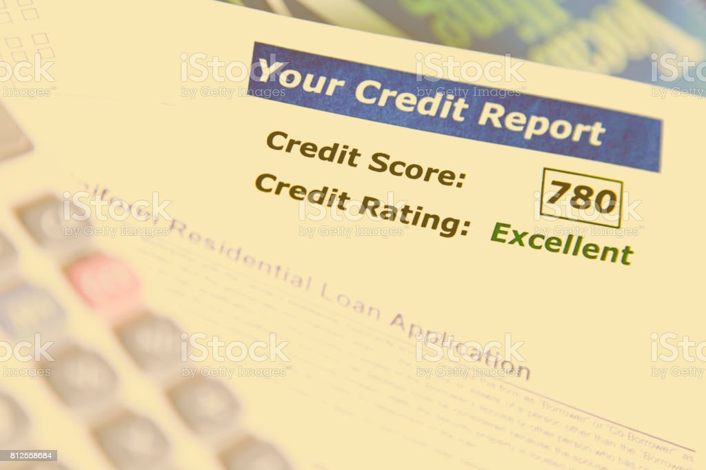 Credit report, score, loan documents and calculator on desk. stock photo