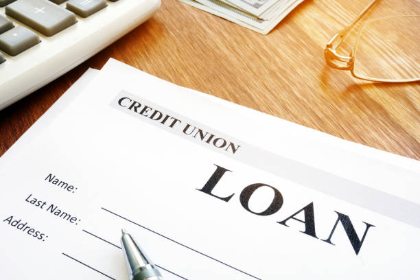 Credit union loan application form and pen. stock photo
