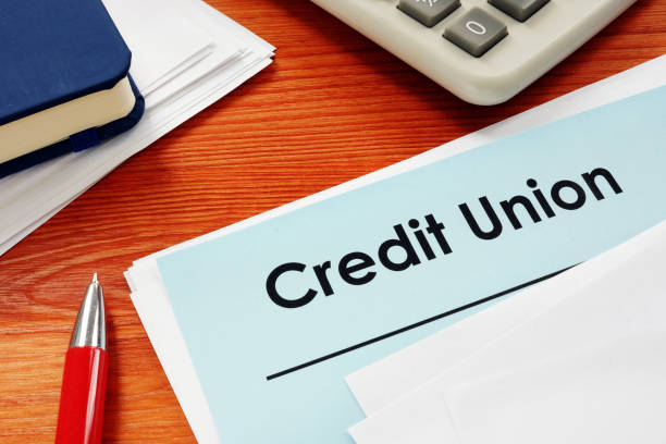 Credit Union papers for loan on desk. stock photo