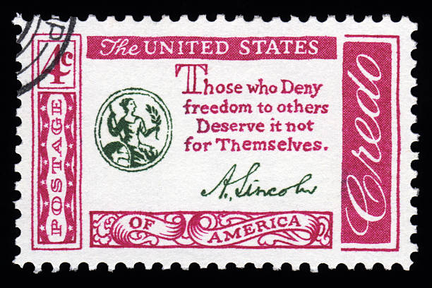 USA Credo Postage Stamp Abraham Lincoln Quotation USA vintage Credo postage stamp with Abraham Lincoln's famous quote 'those who deny freedom to others deserve it not for themselves' signature collection stock pictures, royalty-free photos & images