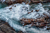 Stream bed with rocks and white water.Stream bed with rocks and white water.