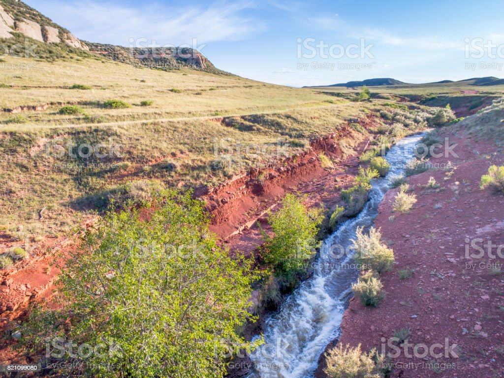 creek in Colorado foothills aerial view stock photo
