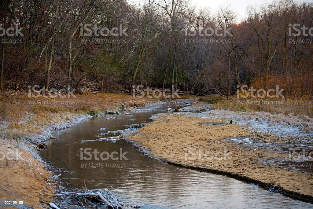 Creek running through the woods stock photo