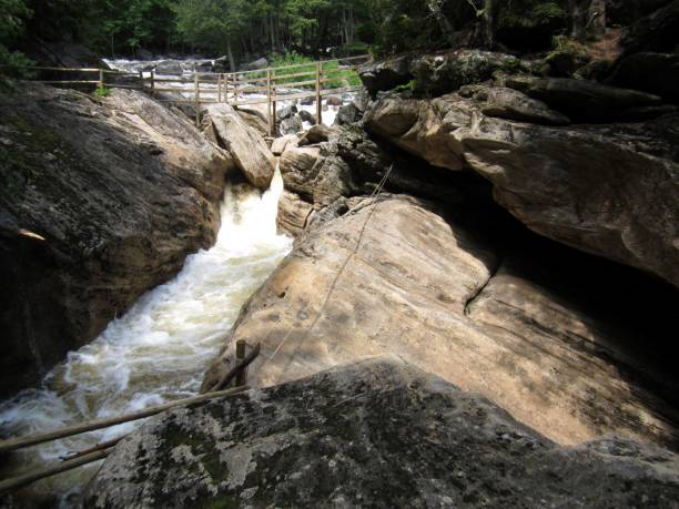 Creek rushing through large boulders stock photo