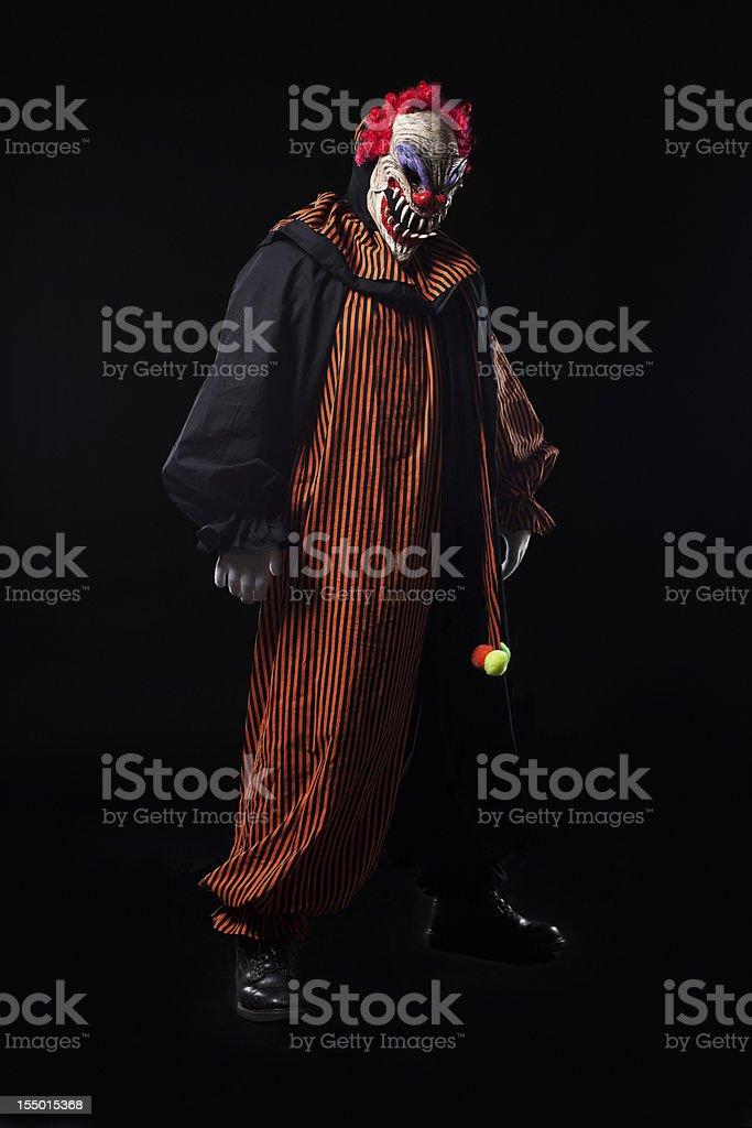 Creepy Adult Clown Halloween Costume Portrait on Black stock photo