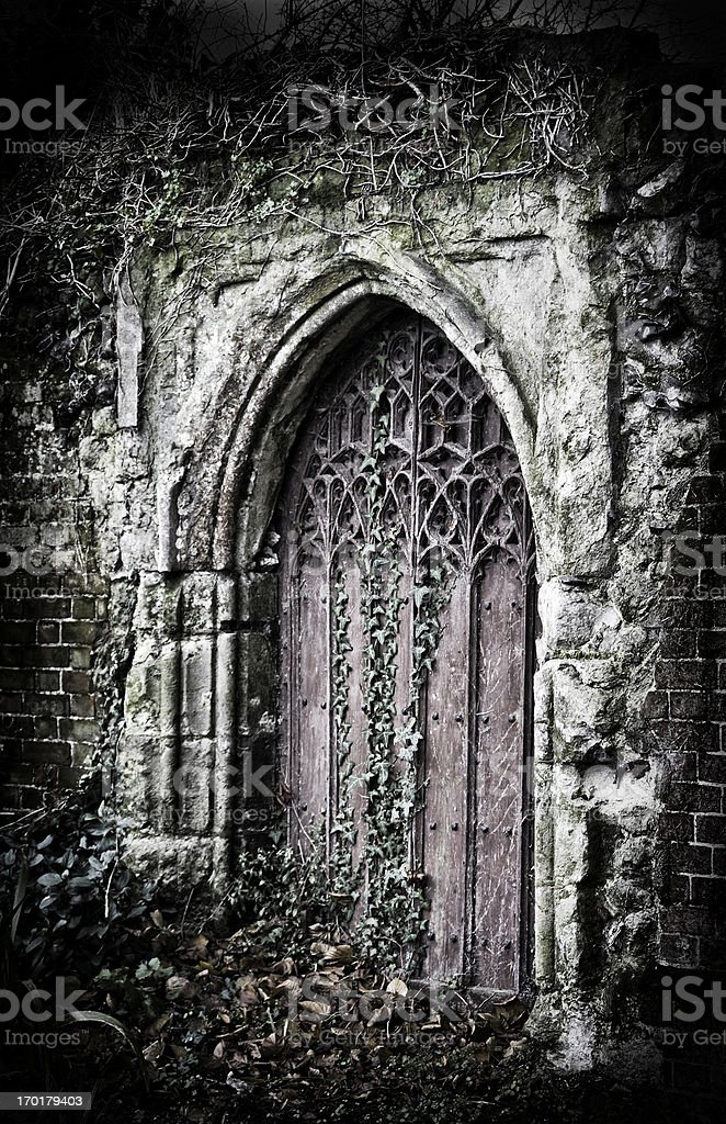 Creepy arched door on an old building royalty-free stock photo  sc 1 st  iStock & Creepy Arched Door On An Old Building Stock Photo u0026 More Pictures of ...