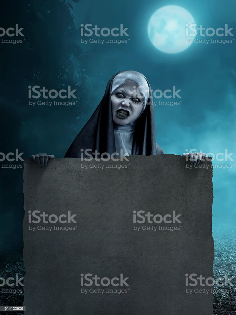 creepy asian nun holding blank parchment paper stock photo & more