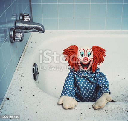 Creepy clown nightmare in the bathtub.