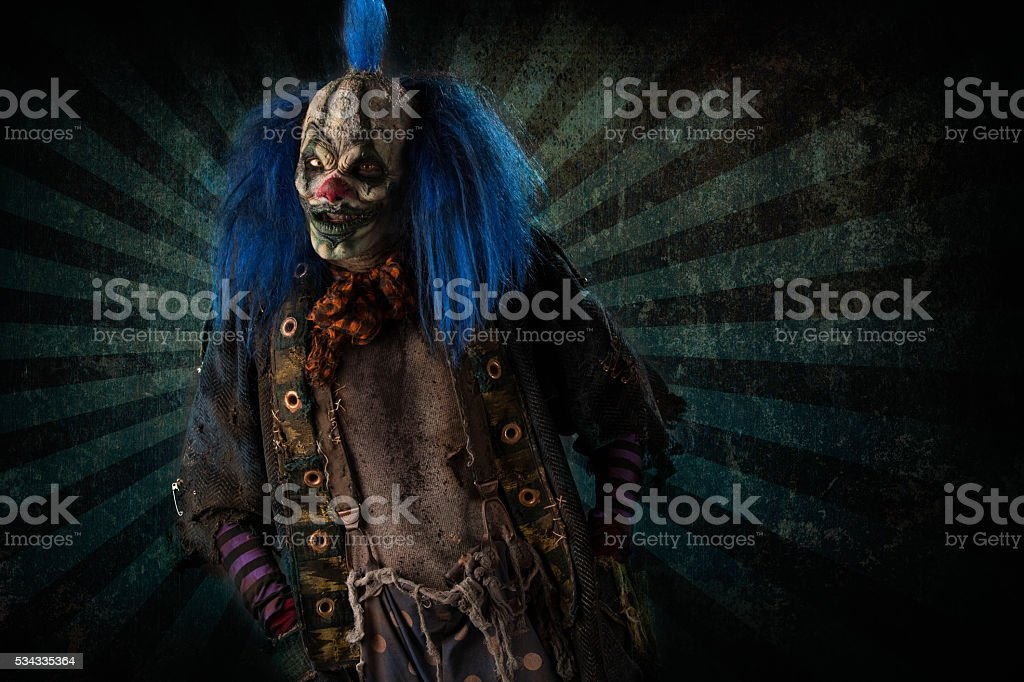 Creepy Clown on striped background stock photo