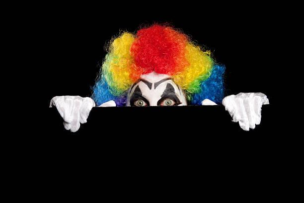Creepy Clown Peeking At You - foto de stock