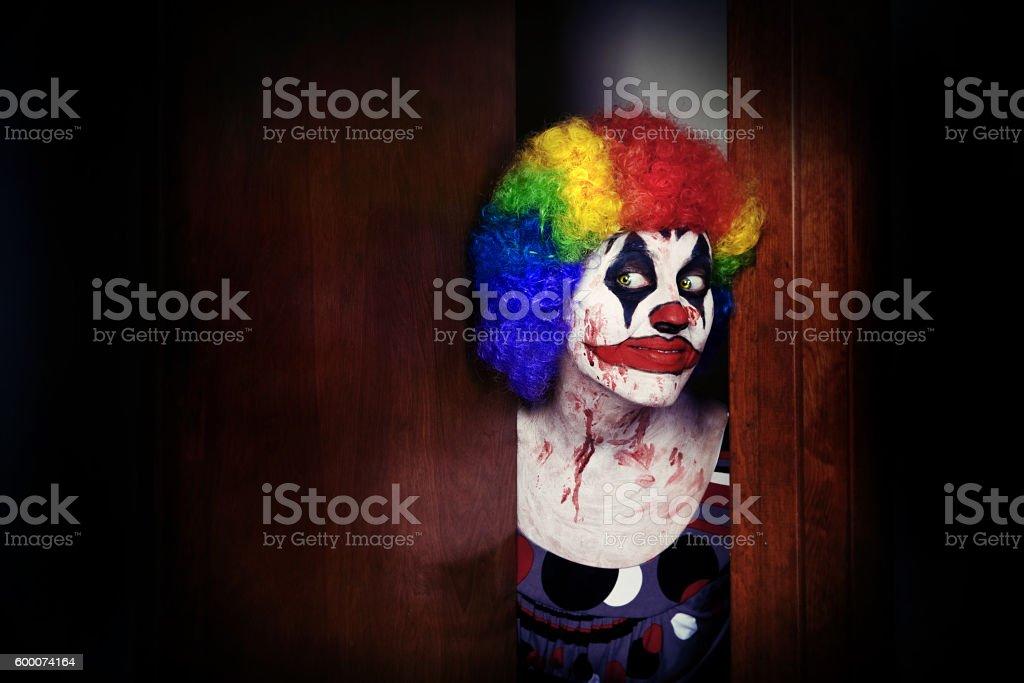 Creepy Clown Peeking Though Door stock photo