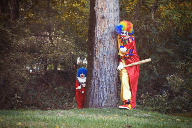Creepy Clowns In The Woods stock photo