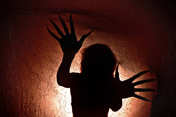 creepy creature silhouette - demon fictional character stock photos and pictures
