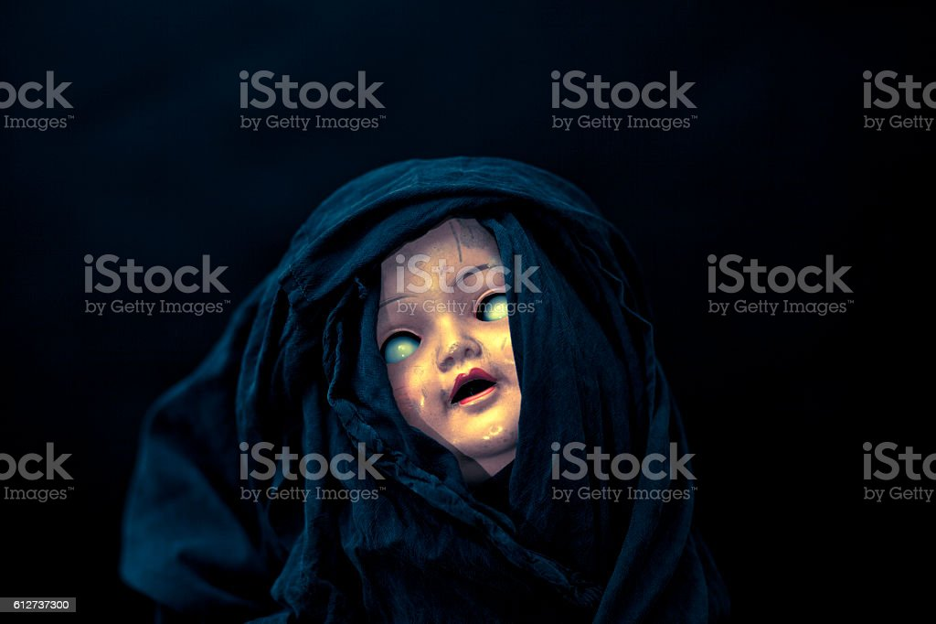 Creepy doll face stock photo