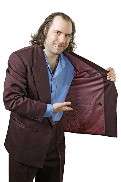 Creepy drug dealer offering drugs Photo of a sleazy drug dealer showing you what he has in his jacket.  Add your own drugs, merchandise, or whatever your vice my be. drug dealer stock pictures, royalty-free photos & images