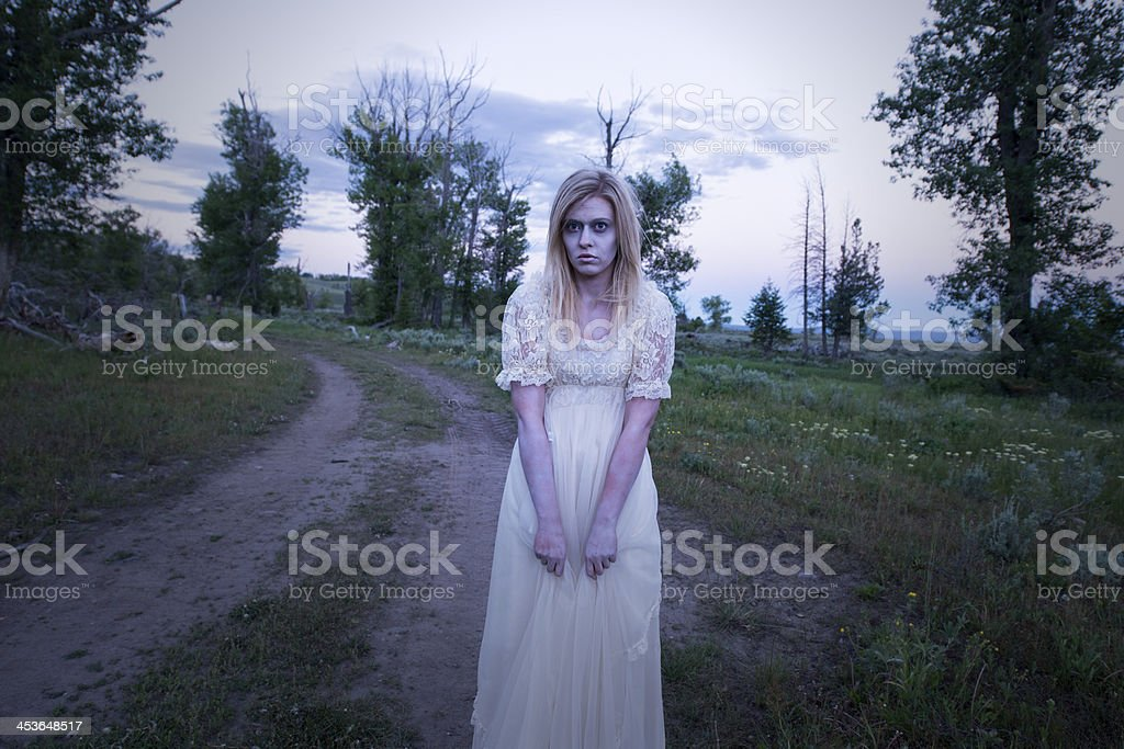 Creepy Ghost Lady in the Woods royalty-free stock photo