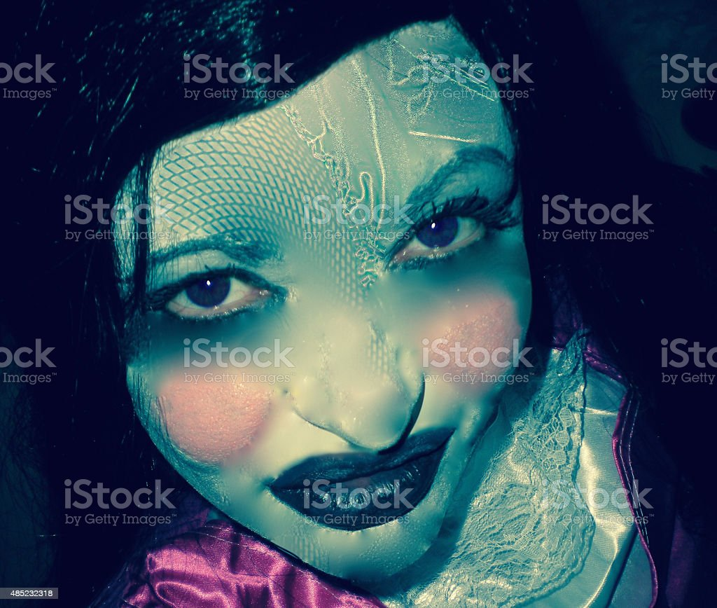 Creepy Living Dolly With Blue Eyes stock photo
