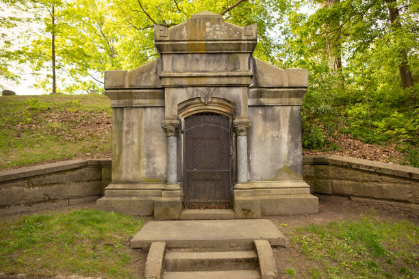 """Creepy Mausoleum Build in Hillside A creepy, nameless mausoleum built into a hillside from the 1800's- urban legend nicknamed """"The Vampire Crypt."""" sdominick stock pictures, royalty-free photos & images"""
