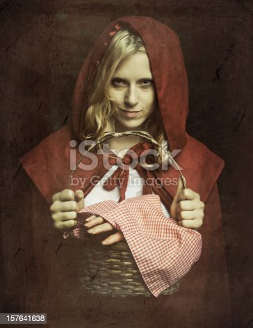 grown up Little Red Riding Hood, carrying a basket which a severed hand in it - grandma are you going to left me your house or what?. it happened in north carolina, usa.