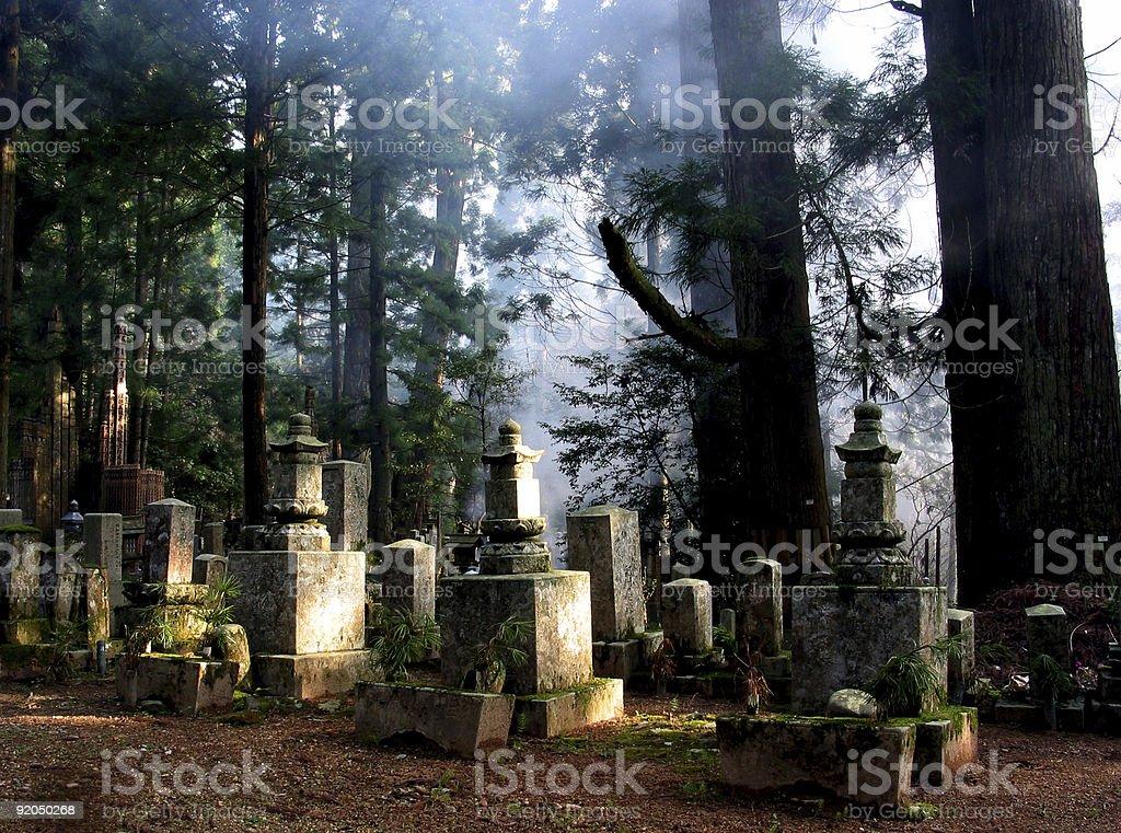 Creepy old Buddhist cemetery at Mt. Koya in Japan royalty-free stock photo