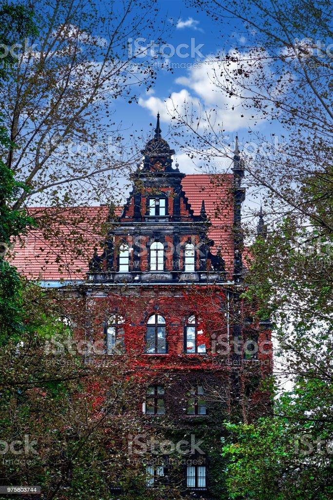 Creepy old house against the blue sky stock photo