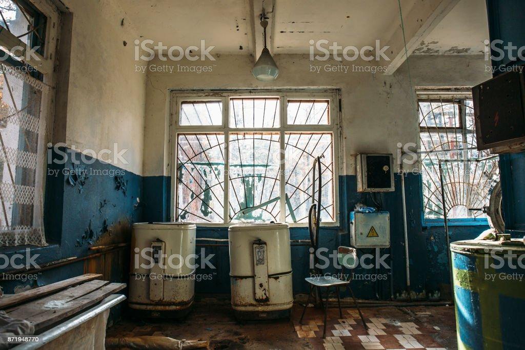 Creepy Old Laundry Room In Abandoned Hospital Royalty Free Stock Photo