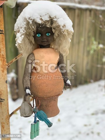 istock Creepy radioactive doll with piercing blue eyes and snow hair from the Chernobyl exclusion zone. 1286661736