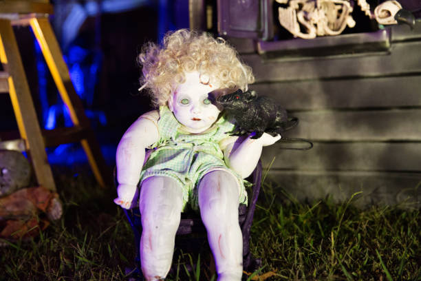 Creepy thrift store doll used in Halloween decor stock photo