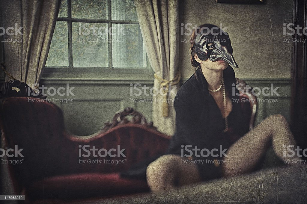 Creepy woman wearing a bizarre mask stock photo