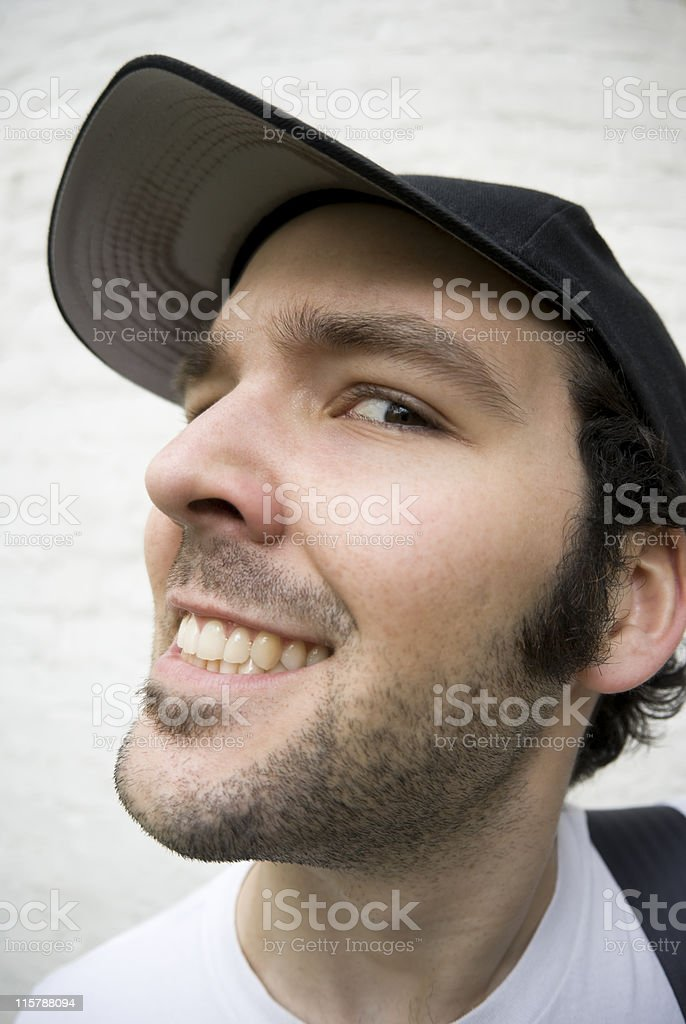 Creepy young man making a face, fisheye portrait royalty-free stock photo