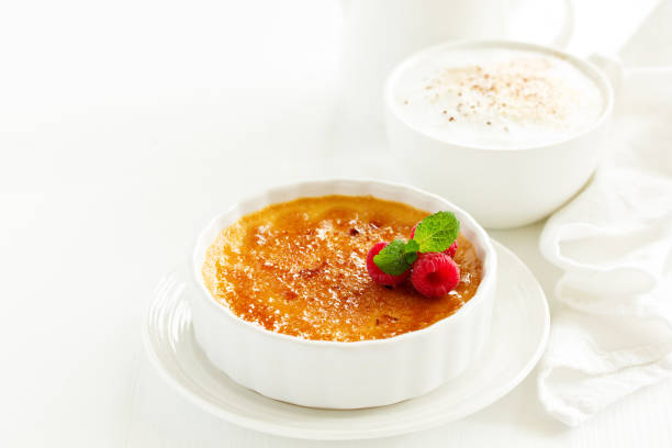 Creme brulee. dessert with caramel crust and berries. stock photo