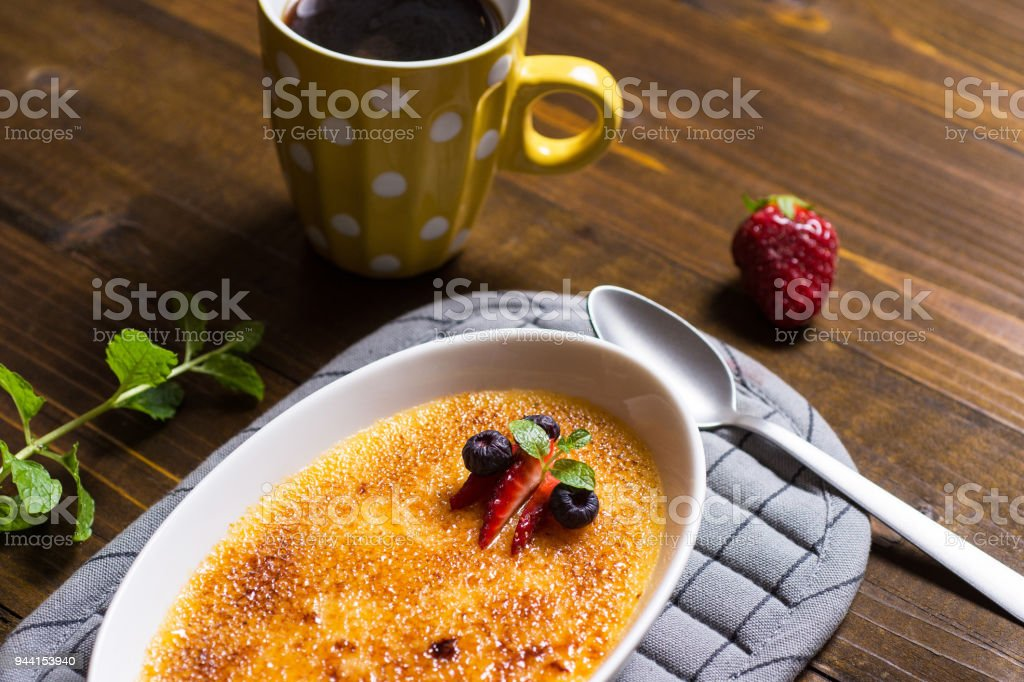 Creme Brulee Dessert with Caramelised Sugar, Strawberry, Blueberry and Fresh Mint Leaves stock photo