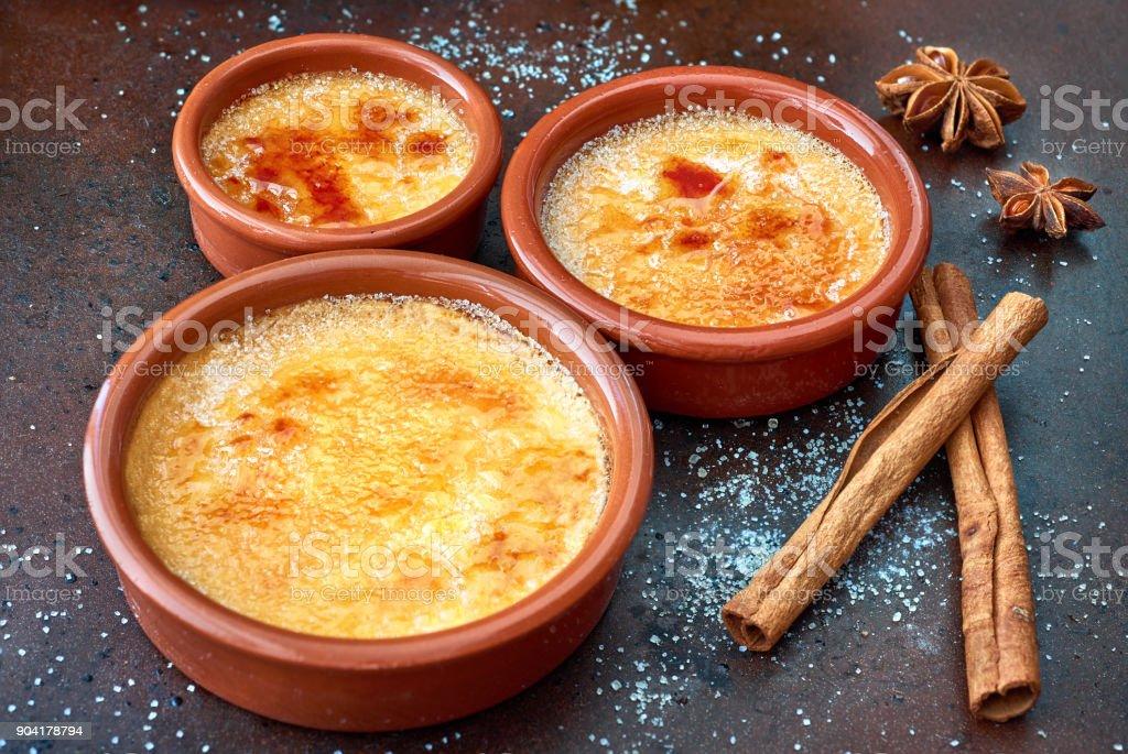 Creme brulee (cream brulee, burnt cream) in terracota baking dishes stock photo