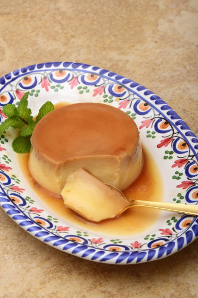 Creme Caramel or Flan on Traditional Spanish Plate stock photo